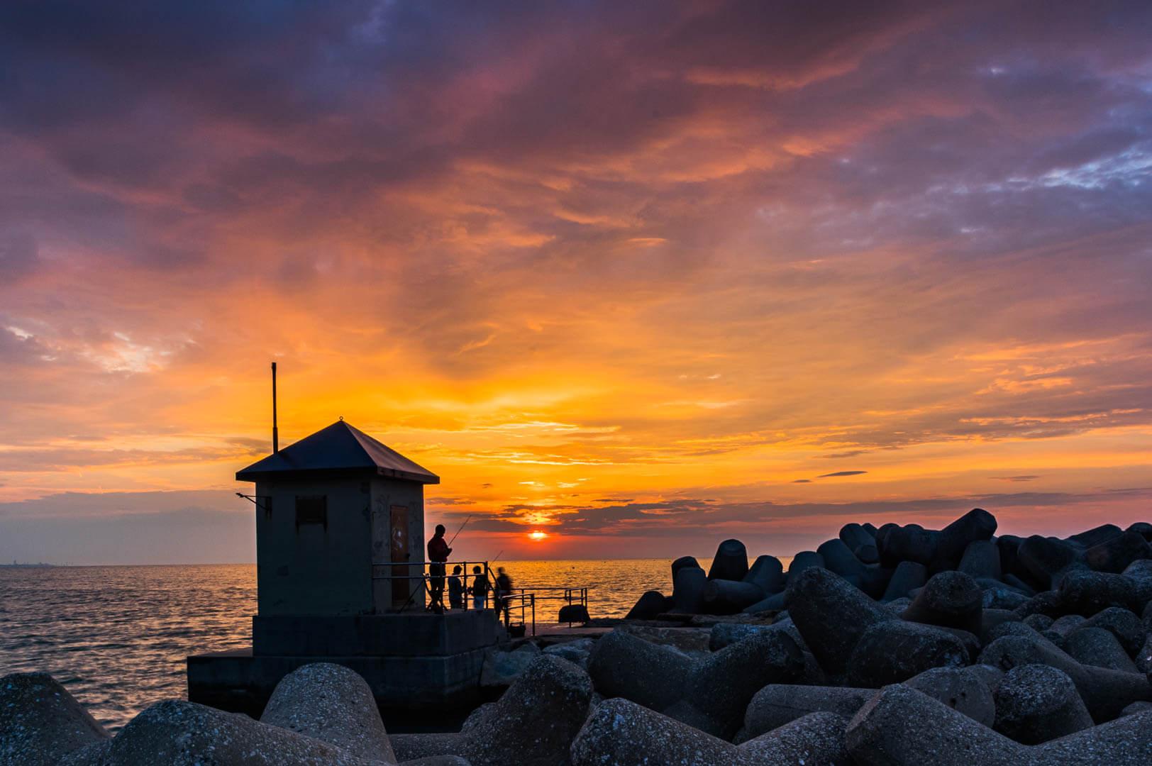 Wetter,Licht und Farben.Fischer im Morgenrot bei Punta Sabbioni